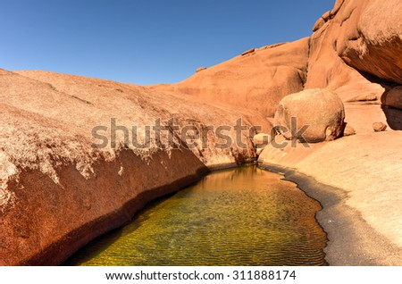 Water hole in Spitzkoppe in the Namib desert of Namibia. - stock photo