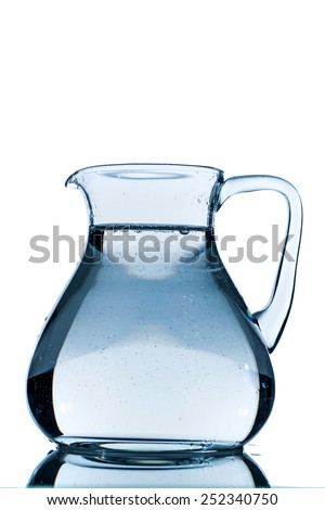 water in a carafe, symbolic photo for drinking water, wealth, supplies and consumables - stock photo