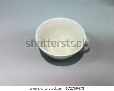 Water in a cup with gray background.