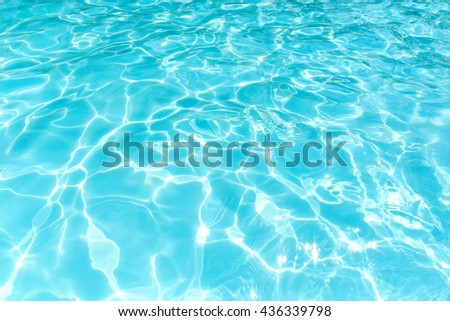 Water in swimming pool, Ripple water with sun reflection, Beautiful shining blue water and bright - stock photo