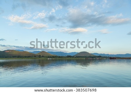 Water in the dam and the mountain Dam water reservoir in the mountains in the background. - stock photo