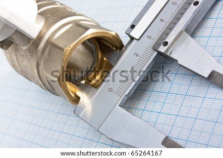 water inlet valve  on a background of graph paper - stock photo