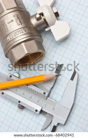 water inlet valve  on a background of graph paper