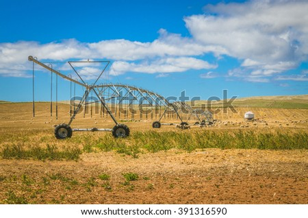 Water irrigation agricultural farm machinery Australian rural field - stock photo
