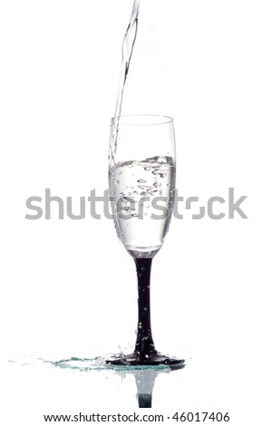 Water is poured into a glass - stock photo