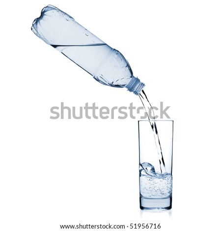 Water is poured into a glass from a bottle. Isolated on white background