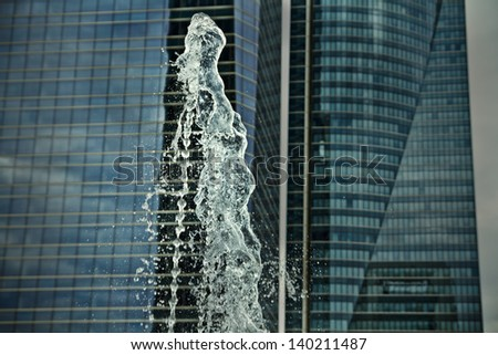 water jets, office building source, towers at background