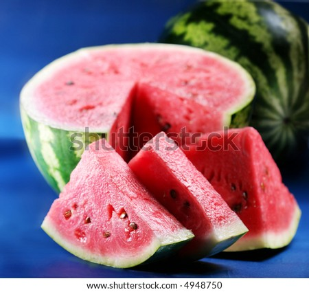 Water-melon; objects on blue background - stock photo
