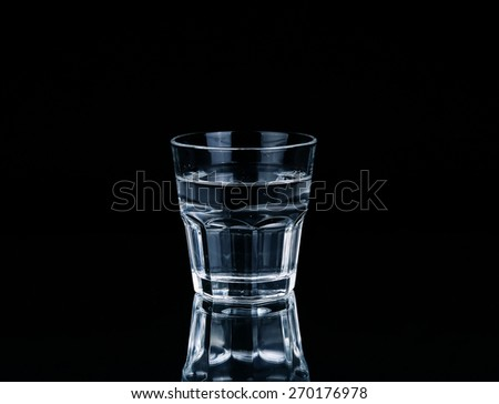 water on a glass on dark background. - stock photo