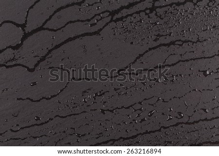 water on stone surface  in black and white - stock photo
