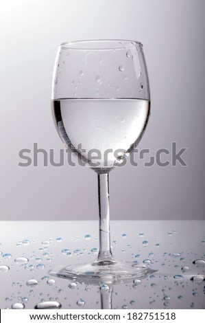 Water on the shiny table, surrounded by drops