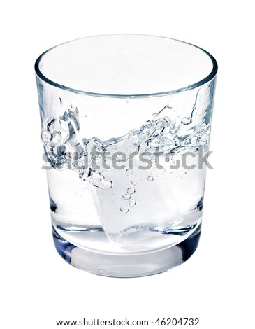 Water or alcohol splashing from ice cube dropped in a glass isolated on white