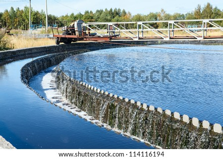 Water overflow from the big sedimentation drainages round form - stock photo