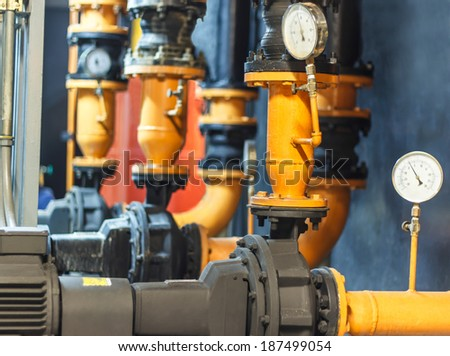 Water pipe connection flange joints with condenser Water pump and pressure gauge , chiller water pump with pressure gauge - stock photo