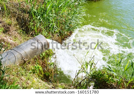 water pipe lake pollution - stock photo