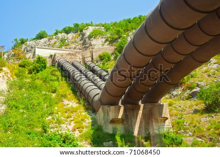 Water pipes in the mountain - stock photo