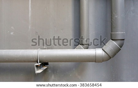 water pipes on cement wall of building