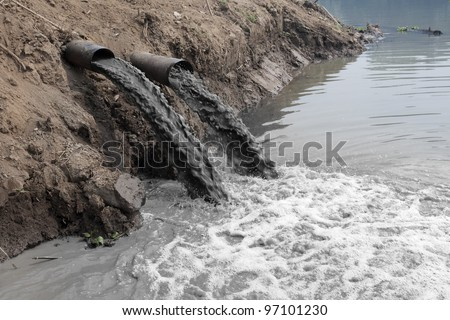 Water pollution in river because industrial not treat water before drain.