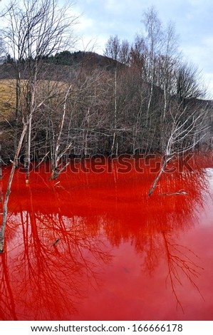 Water pollution of a gold mine exploitation in Rosia Montana, Romania - stock photo
