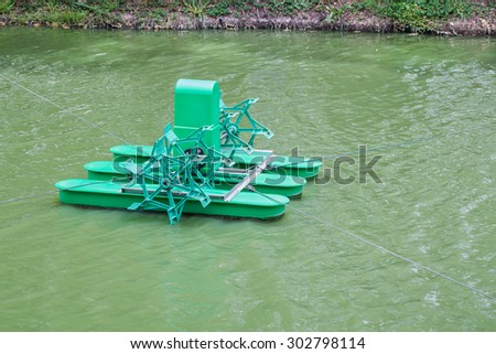 water pollution treatment machine, aerator, Chai Pattana, Thailand - stock photo