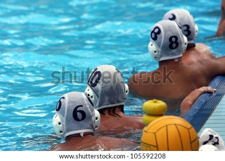 water polo players resting in a swimming pool