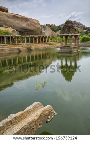 water pool and temple at Krishna market, Hampi, India - stock photo