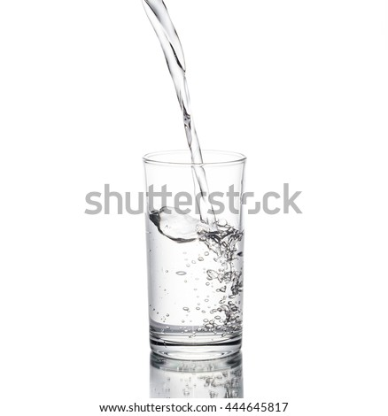Water poured in a glass transparent white background