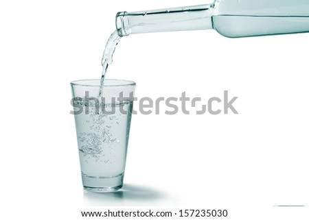 Water poured into water glass white background - stock photo