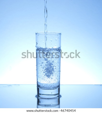Water pouring in a glass - stock photo