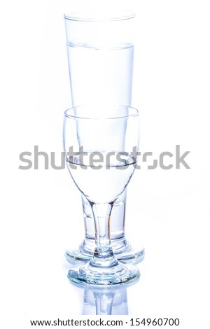 water pouring in a glass on white background.