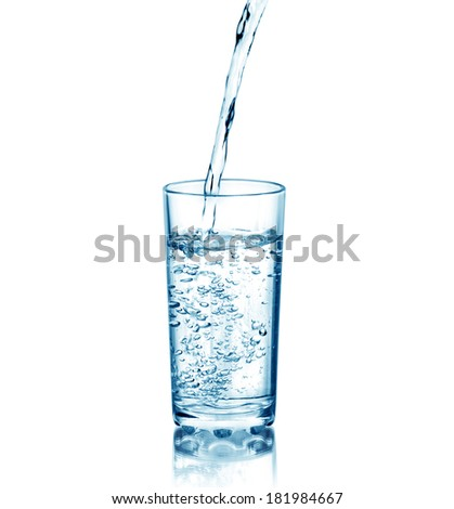 Water pouring in glass, isolated on white