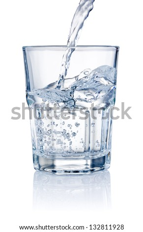 Water pouring into glasses isolated on a white background - stock photo