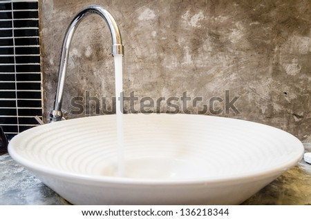 water pours out of the tap - stock photo