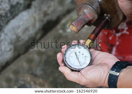 water pressure gauge, fire hydrant - stock photo