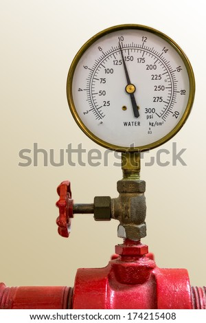 Water pressure meter installed on a red pipe - stock photo