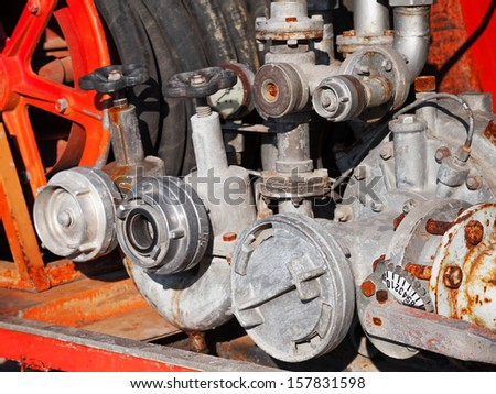 Water pump with hydrants. Firefighters Equipment of old fire truck - stock photo