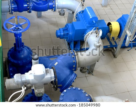 Water pumping station, industrial interior and pipes. Water system valves, electronic motor control water supply - stock photo