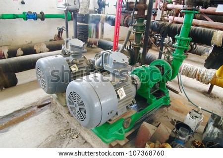 Water pumping station, industrial interior electric water pump  and pipes - stock photo