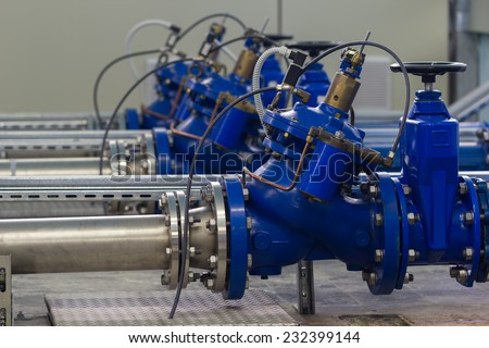 Water pumping station with booster pump control valves. - stock photo