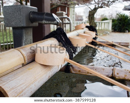Water purification at entrance of the Japanese temple - stock photo