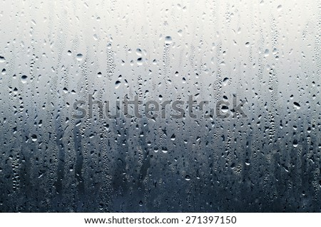 Water Rain Drop on the Grass in The Night Raining Season for Texture Background - stock photo