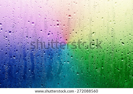 Water Rain Drop on the Rainbow Grass in The Night Raining Season for Texture Background - stock photo