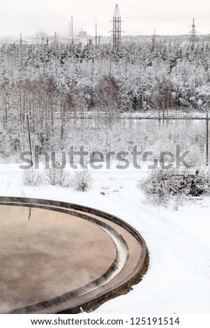 Water recycling in sewage settlers in winter season - stock photo