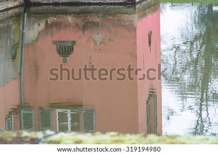 Water Reflection of an old moated castle near Dusseldorf Kaiserswerth. - stock photo