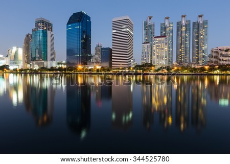 Water reflection of city downtown during twilight