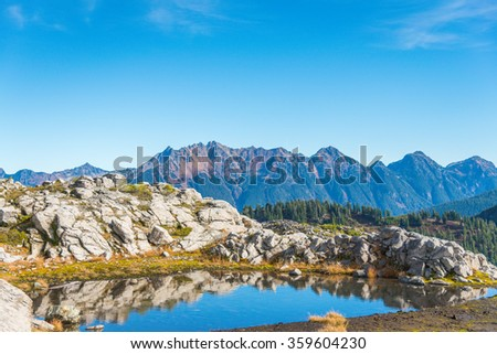 water reflection of the top mountain,some scenic view of mt Shuksan in Artist point area on the day,summer,Washington,USA. - stock photo