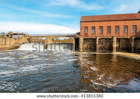 Water reservoir of the old abandoned hydroelectric power station - stock photo