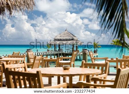 Water restaurant - ocean and sky view, Kuramathi island, Maldives - stock photo