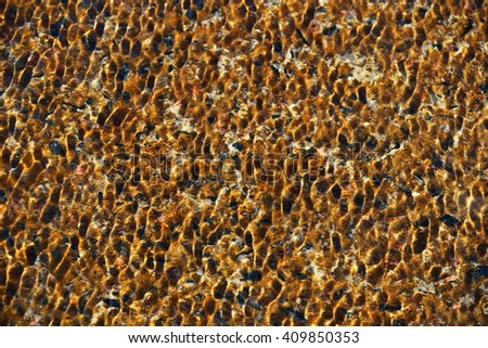 Water ripple texture with orange sand background