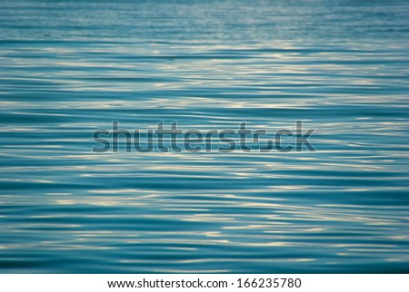 Water ripples on a surface lake - stock photo